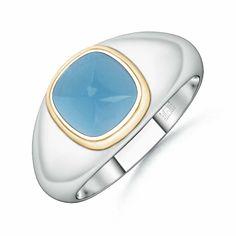 This two tone blue topaz ring radiates a distinctive style. The sugarloaf Swiss blue topaz, bezel set on the broad yet lustrous shank, allures with its vivid hue.