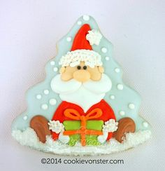 I love that it's the shape of a Christmas tree but has Santa as the eye catcher!  Clever!