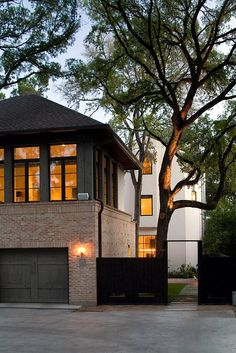 Carriage house in Mexican Sand brick w/ door clad in stained cedar planking; Hugh Jefferson Randolph Architects