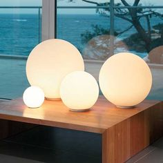 Dioscuri Table Lamp | Artemide at Lightology | Coastal Lighting Globe Ball Lamp