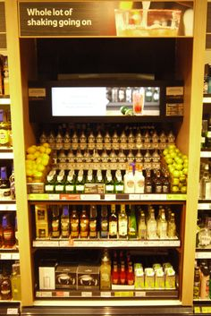 Cross merchandising, cocktail video demonstration & recipe cards - spirits aisle