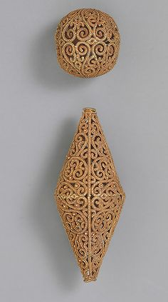 Two beads, 11th century; Fatimid Syria Gold, fabricated from wire and strips of sheet, decorated with granulation; L. 2 in. (5.1 cm), Max Diam. 1 in. (2.5 cm); Diam. 3/4 in. (1.9 cm) Purchase, Sheikh Nasser Sabah al–Ahmed al–Sabah Gift, in memory of Richard Ettinghausen, 1980 (1980.456) Purchase, Mobil Foundation Inc. Gift, 1980 (1980.457)