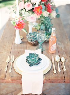 using succulents is spot on-trend for this year. this succulent adds a nice punch of blue to this table setting. the florals really stand out because the table and plating is kept neutral.