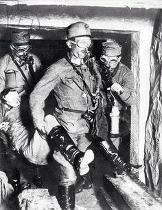 Austrian soldiers carrying an unconscious companion out of a mine gallery on the Italian front, 1918.