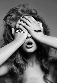 Editorial: This shot was for a skin care product. It caught my eyes with the unique way that the model is posing with her hands and using make up to mock the image of real eyes. It is also unique for being in black and white but still gathers someones attention like if it were in color.