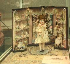 Amazingly detailed dressed dolls in several scales in this doll trunk display exhibited by Nancy Richmond at the Spring 2009 Seattle Dollhouse Show.