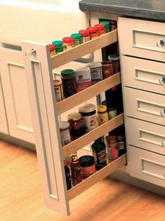 20 Smart Kitchen Storage Ideas - Small-Space Solutions – 20 Smart Kitchen Storage Ideas on HGTV Hidden spice rack? Clever Kitchen Storage, Kitchen Cabinet Organization, Smart Kitchen, Storage Cabinets, Kitchen Pantry, Wall Cabinets, Organized Kitchen, Kitchen Small, Spice Cabinets