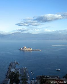 View from the top of #Akronafplia Hill with the #Bourtzi fortress right in the center of the port of #Nafplio in the #Peloponnese - #Greece