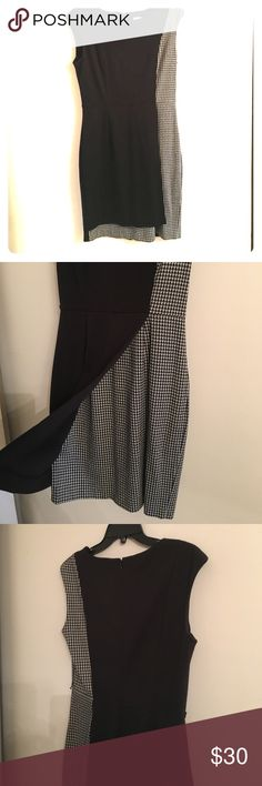 Calvin Klein Houndstooth Panel dress Great dress for work! It has black body with houndstooth fabric under the front paneling on the skirt. Fabulous with with a crisp belt and great pumps! Calvin Klein Dresses Midi