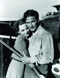 Errol Flynn (Olivia de Haviland, in Dodge City, 1939) - Yes, well before my time, however as a kid I knew how to watch reruns! And when Errol Flynn was on the TV, time stopped, my heart did funny things, and I always forgot to breathe. He was my first crush. To this day, whenever I look at his picture, I feel all warm and soft and melty. Hot. Breathless. Hmm... Put like that, I don't think I ever got over him. And I'm just fine with that.