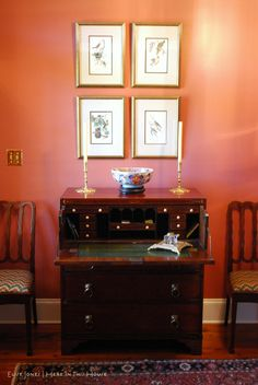 Carla's antique butler's desk under a collection of octavo edition Audubon prints. Displayed on the desk are 17th century brass candlesticks and a large Imari bowl from Tokyo.