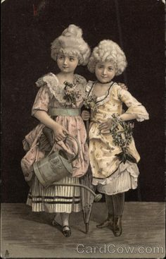 Young Girls in Victorian Attire