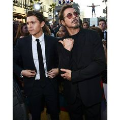 """Tom with Robert Downey Jr. at the World Premiere of """"Spider-Man: Homecoming"""" at TCL Chinese Theatre in Hollywood, California (06/28)! Swipe to see the full HQ gallery @tomholland2013 