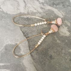 These super pretty faceted peach moonstone dangles are layered with gold plated Bali style daisies, tiny gold plated Swarovksi crystal rondelles and tiny Swarovski pearls. They drop from gold plated kidney hoops also layered with tiny Swarovski pearls & gold seed beads.   The earrings measure appro
