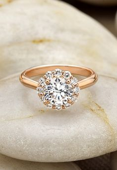 The subtle floral diamond halo blooms around the center diamond in this exquisite rose gold Brilliant Earth ring #fashion #style