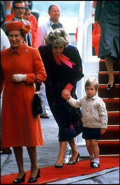 Princess Diana with Queen Elizabeth II and Prince William, leaving the Royal Yacht. Diana in pink and blue tartan.