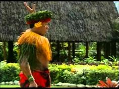 PCC - ( Polynesian Culture Center) Hawaii. Samoan funny guy performs his Coconut Husk and Tree Climb act.