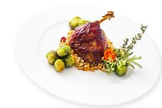 Duck's thigh - with plum glaze and served with buckwheat groats with vegetables and brussels sprouts in butter bath