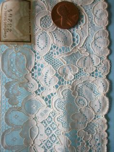 Alencon Lace - Needle lace originally from Alencon France.  Designs usually are flowers and leaves done on a shear mesh