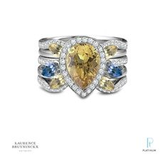 This Laurence Bruyninckx ring is composed of a yellow beryl center stone with a diamond halo. The colored gems used have special developed flat table top cut. This gives the piece a very modern look. There are also two pear shaped peridot stones with a total of four yellow beryl marquise side stones. Diamonds frame the whole piece. #BePlatinum