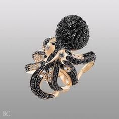 Octopus ring in 18k rose gold, black sapphires and diamonds.  By Roberto Coin.
