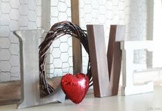 Rustic LOVE letters. Valentine's Day mantel decor. #valentinesday