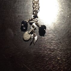 Origami owl necklace with four charms. Selling an origami owl necklace but for charms including a black and purple stone the angel wings and the family tree medallion Origami Owl Jewelry Necklaces