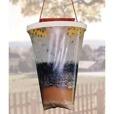 NON TOXIC outdoor fly trap. $15 Use anywhere flies are a problem, including your backyard, in horse stables, poultry operations, dairy farms, kennels, etc. It even traps fruit flies.    The Ultra Biomass Bait is a blend of non-toxic sterilized food materials (carbohydrates, protein, fats, minerals and stabilizers) developed by leading university researchers, and does not produce an aroma detectable by humans.