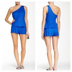 One shoulder short romper by Vitamin A One shoulder semi sheer short romper with side slits and tie waist. Easy fit. Perfect with strapless Bikini or any bathing suit. Festival or pool side must have! Vitamin A. Worn once as beach cover up. Vitamin A Shorts