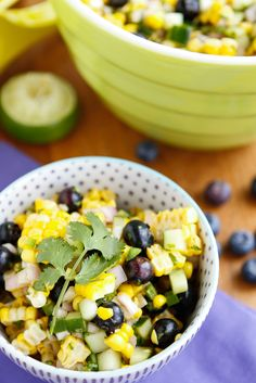 Fresh Corn Salad -- this amazing sweet corn salad gets an unexpected twist with the addition of juicy, in season blueberries. It takes advantage of some of my favorite summer produce in a totally unexpected and delicious way!
