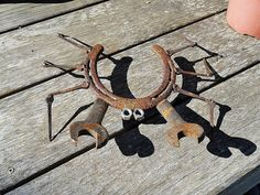 This little guy is made of a horseshoe and stands on horseshoe nail legs with nuts for eyes and wrenches for claws. He comes weathered and AS IS; to naturally rust outdoors. Sizes and shapes and condition vary a bit since they are made of used/recycled horse shoes and wrenches.