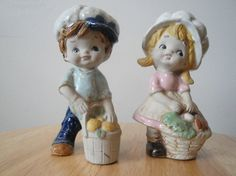 Vintage Boy & Girl Napcoware Figurines from the 1960s. These are darling figurines of a boy and girl with baskets. The girl is wearing a pink dress and the boy is wear a light blue shirt and dark blue pants. They both have #C-9188 on the bottom and the girl has the original Napcoware Sticker on the bottom which shows Made in Japan. No chips or cracks. They will make a lovely addition to a curio cabinet, mantel or shelf. Measurements: 5 high and 2-1/2 wide.  PAYMENT AND SHIPPING POLIC...
