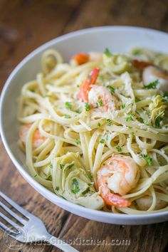 This shrimp and artichoke linguine pasta is a 30-minute meal! It has a fresh and light lemon herb sauce - DELICIOUS!! | natashaskitchen.com