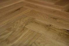 """Herringbone flooring is what most people mean when they refer to """"Parquet Flooring"""" 18mm in thickness, with a low maintenance brushed and matt lacquered finish."""