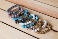 Add a touch of nature to any outfit with this beaded bracelet designed and handmade in the South featuring semi-precious gemstones and gold floral accent. Complete any look with a single bracelet or s