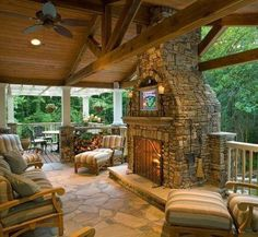 Log cabin patio with fireplace