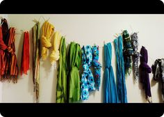 How I store my many scarves--Nail string to wall in a few places, buy clothes pins, put scarves up in desired pattern. Ta-da!
