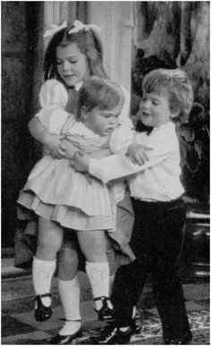 Princess Victoria and Prince Carl Philip playing with their younger sister Princess Madeleine