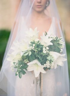 Ivory amaryllis and greenery wedding bouquet: http://www.stylemepretty.com/2014/03/26/an-italy-workshop-the-wedding-inspiration/ Photography: Jose Villa - http://josevillablog.com/