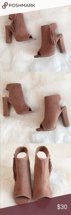 Suede open toed light brown tassel platform heels Suede open toed light brown tassel platform heels in a size 5.5. These are brand new and have never been worn! Charlotte Russe Shoes Heeled Boots