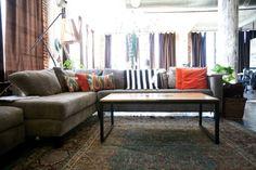 Painted concrete floor, turkish rug, and wood/iron minimalist coffee table.