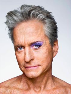 Picture of Michael Douglas with one eye bare and one eye made up with purple eyeshadow and eyeliner