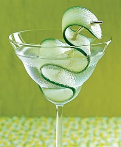 Saketini    Warm day, cool drink: Sake replaces vermouth in this Asian-style martini.    - 2 oz. Ketel One Vodka  - 2 oz. Masumi Okuden Kantsukuri Sake  - Strip or slice of seedless cucumber (for garnish)