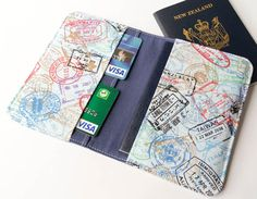 Handmade Fabric Passport  Cover / Wallet / Case in World Travel Stamps. $15.00, via Etsy.