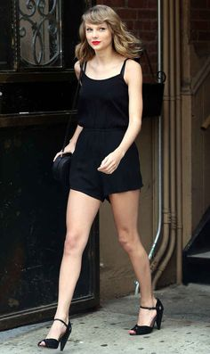 Give her a black playsuit and some red lipstick and she will strut. | Is There Anyone Who Struts As Well As Taylor Swift?