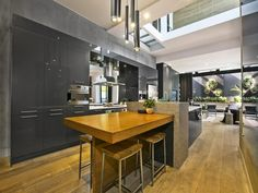 Alisa & Lysandra's kitchen on The Block beautiful shades of grey, wooden kitchen bar & open plan to outdoor courtyard Kitchen Benches, Wooden Kitchen, Kitchen Dining, Kitchen Doors, Dining Area, The Block Kitchen, The Block Glasshouse, Apartment Kitchen, Glass House