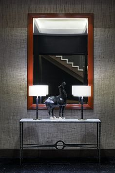 The Millennium Tower Boston interiors experience is rooted in the style of the late cool of The Thomas Crown Affair. Thomas Crown Affair, Boston Interiors, Oversized Mirror, Tower, Architecture, Luxury, Furniture, Home Decor, Arquitetura