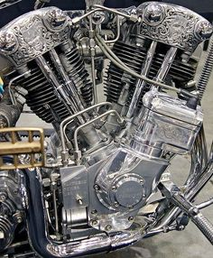 (Engraved knucklehead engine with magneto and rigid stainless oil lines by Chemical Candy Customs)