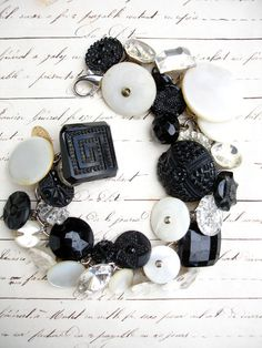 This bracelet has all vintage glass and mother of pearl buttons in black, white and mirror! Overall length is approx. 7 1/2 but can be