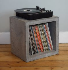 Cubo di stoccaggio cemento solido per vinile lp A handmade cement storage cube designed to accommodate LPS but just as easily can be used as a coffee table. Each cube has its own unique surface detail Vinyl Shelf, Vinyl Record Storage, Cube Storage, Storage Ideas, Lp Vinyl, Vinyl Records, Lp Regal, Cubes, Cube Design